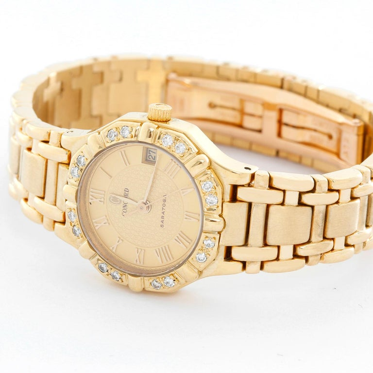 Concord Ladies 18K Yellow Gold  Saratoga Ladies Watch  - Quartz. 18K Yellow gold with diamond bezel ( 24 mm ) . Textured Champagne dial with Roman numerals . 18K Yellow gold link bracelet with deployant clasp . Pre-owned with custom box. Will fit a