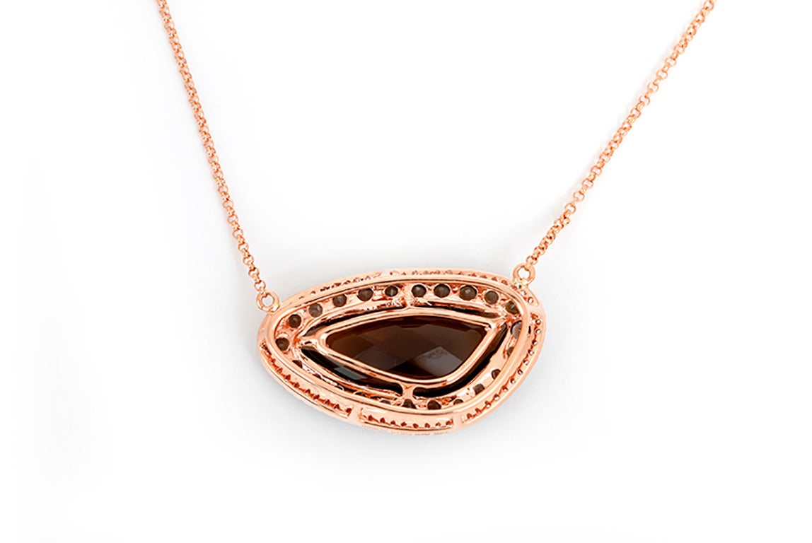 This beautiful necklace features 1 piece smoky quartz and apx. 0.19 carats of diamonds set in 14k rose gold. The pendant measures apx. 1-inch in width at the widest and 5/8-inch in length at the longest. This necklace measures apx. 16-17 inches in