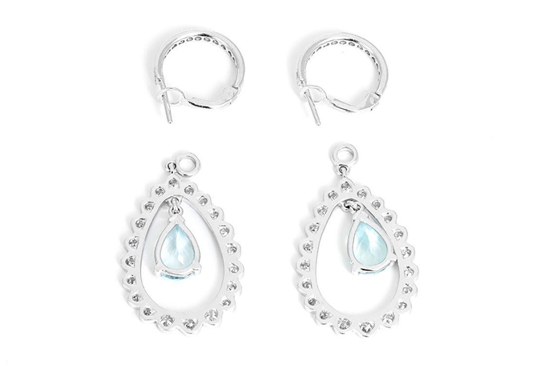 These amazing earrings feature suspended  aquamarine (apx. 3.95 ctw.) and diamond (apx. 1.50 ctw.)  pendants set in 18k white gold. Earrings measure apx. 1-5/8 inches in length.  Total weight is 11.50 grams.