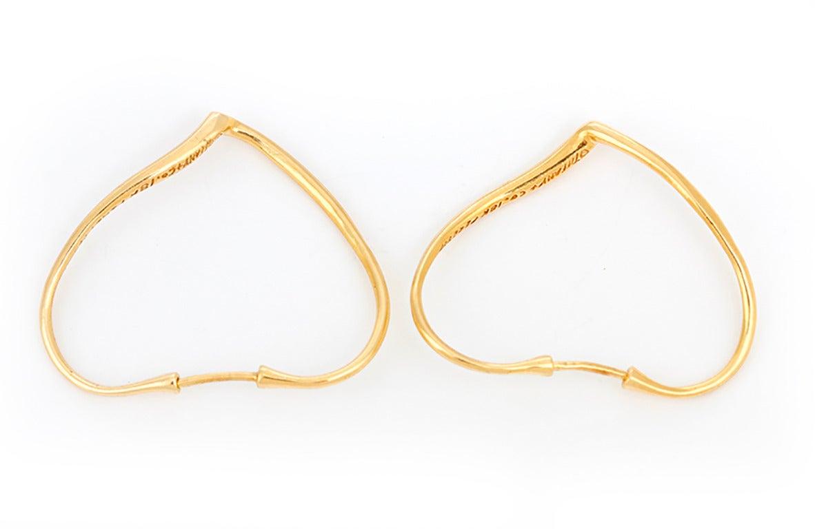 b9d5de4f5 These Tiffany & Co. Elsa Peretti Open Heart earrings in 18k yellow gold  measure apx