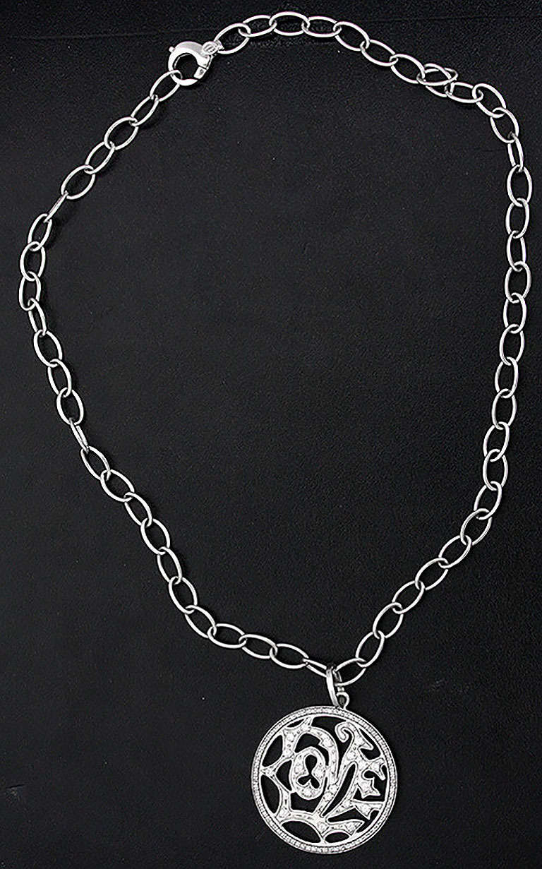 Beautiful White Gold and Diamond LOVE Pendant For Sale at ...