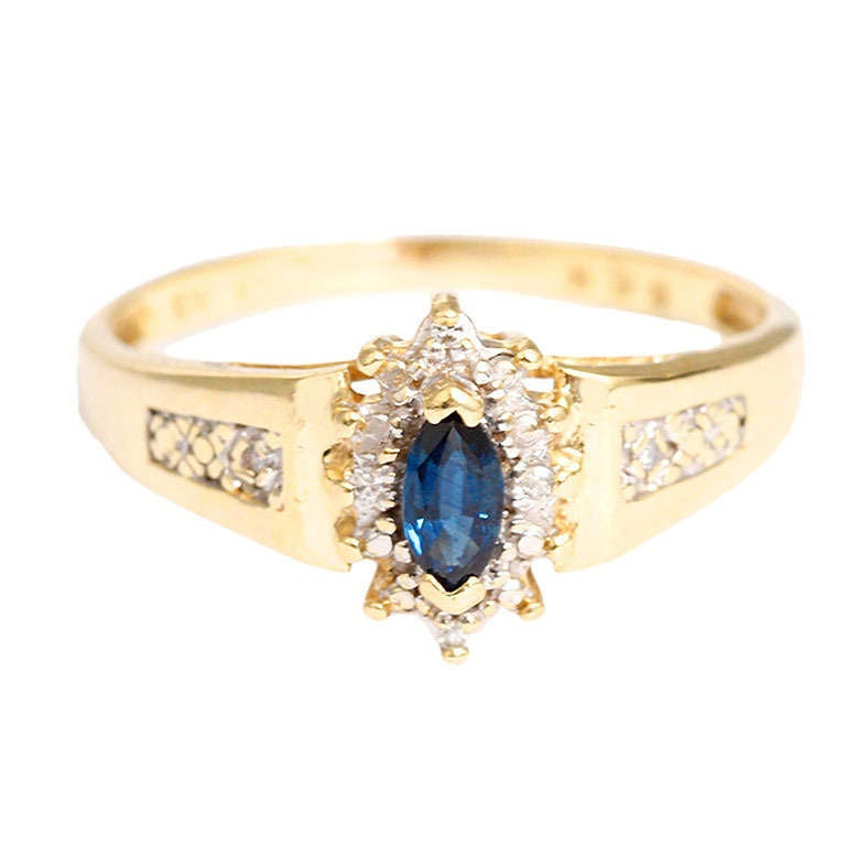 sweet yellow gold and synthetic sapphire ring surrounded