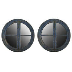 A pair of big round frame mirrors.