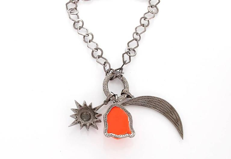 This beautiful bohemian inspired necklace features  diamond crescent moon and star pendants with a coral Buddha pendant outlined by  diamonds on a diamond oval clasp; all set in oxidized silver. Sterling silver chain measures apx. 36-inches in