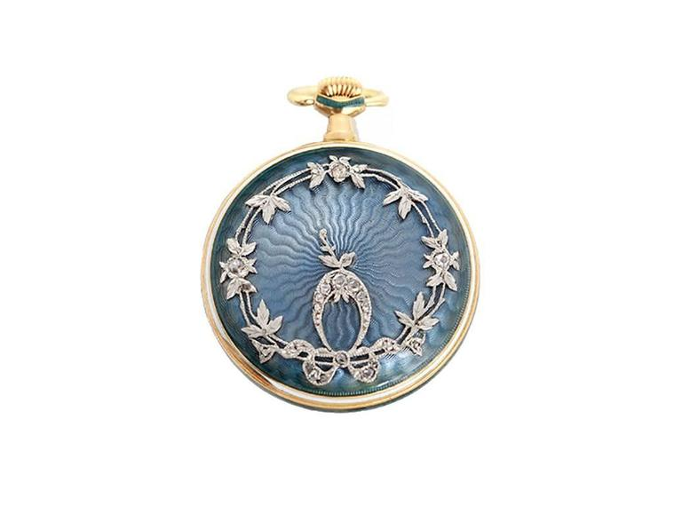 Manual winding. 18k gold and enamel case  (28mm diameter). Case back is engine turned blue enamel  with raised white gold and diamonds in a vine design. Gold engine turned sunray dial with black Roman numerals. Made my well known, high-end,