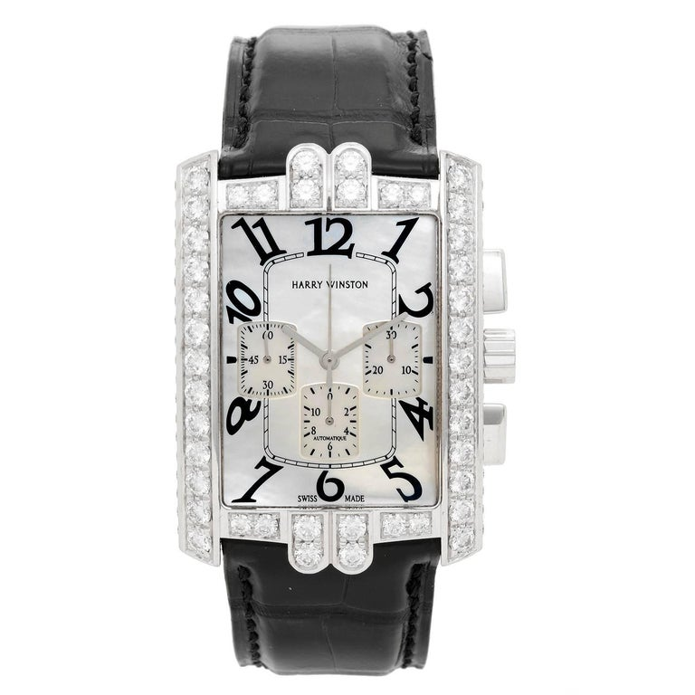 Harry Winston Avenue C Chrono Watch AVCACH32WW006 -  Automatic. 18K White Gold with 5.58 cts of pave diamonds around bezel, case, crown and buckle. White Mother of Pearl. Black alligator strap with 18K White gold tang buckle closure. Pre-owned with