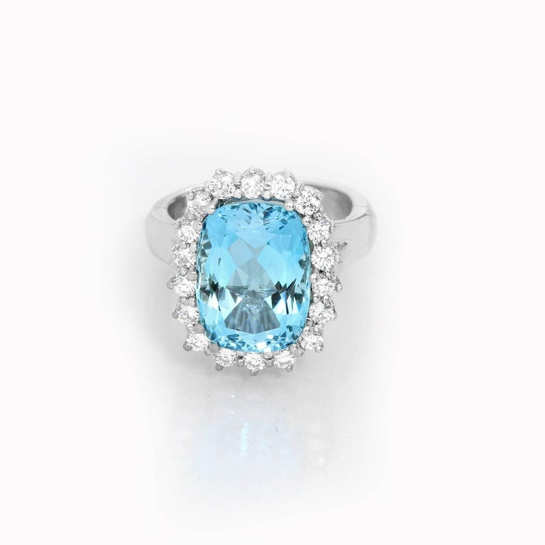 14K White Gold Blue Topaz and Diamond Ring Size 5 3/4 - . Oval mixed cut Blue topaz set in 14K White gold surrounded by Round brilliant cut diamonds. Size 5 3/4.