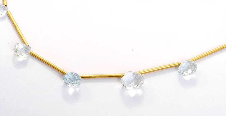 This is a beautiful 14k yellow gold set with aquamarine. The necklace measures apx. 15-1/2 to  apx. 16-3/4 inches in length and is adjustable. The earring hoop diameter measures apx. 5/8- inch with a drop length of 1-1/8 inches.  Total weight is