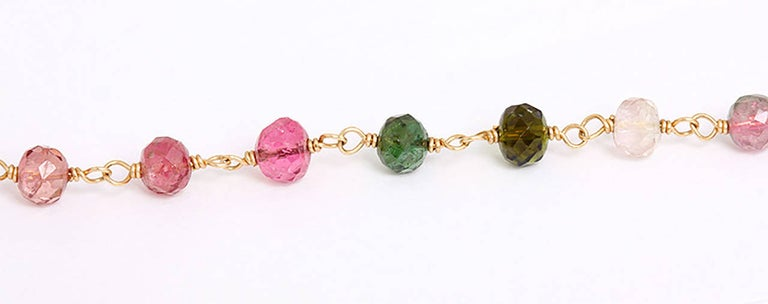 Composed of various colored tourmaline faceted beads, earpendants en suite.  Necklace 20 inches in length with a total weight of 14.2 grams and is signed.