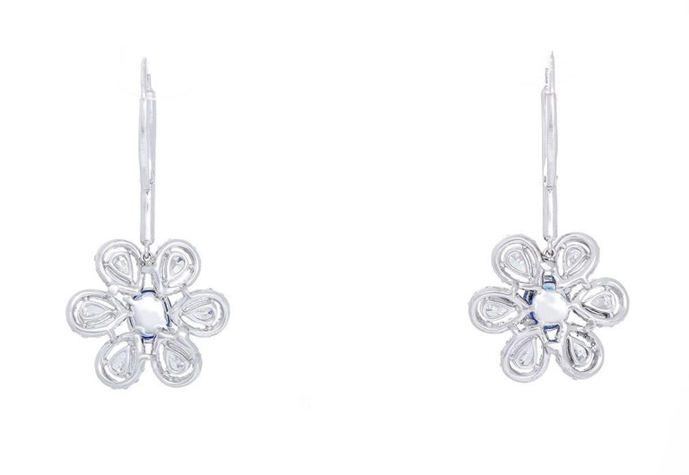 These  flower pendant earrings feature 2.81 cts. of sapphires, 2.21 cts. of pear shaped diamonds, and 1.36 cts. of round diamonds suspended on a 0.20 ct. diamond dangle. Flower pendants measure apx. 3/4-inch in diameter. Earrings measure apx. 1-1/2