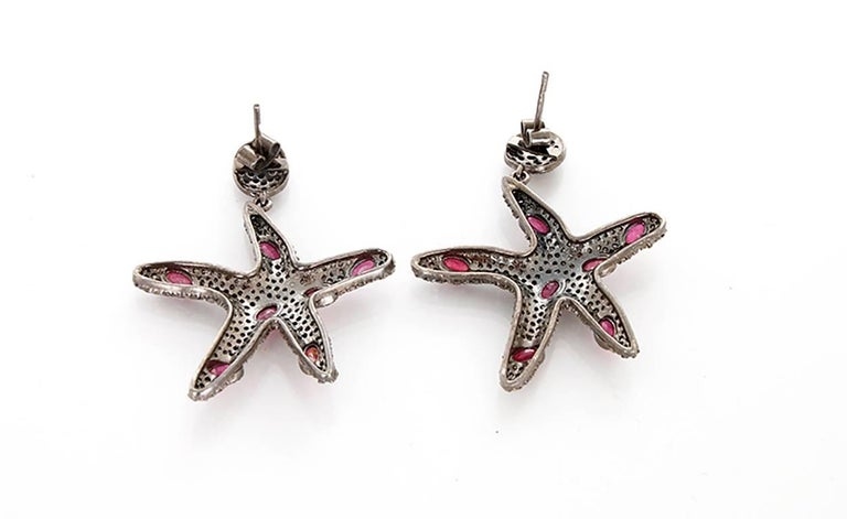 These beautiful earrings feature rubies and 4.07 cts of  diamonds set in oxidized sterling silver. Earrings measure apx. 2-inches in length.  Total weight is 15.8 grams.