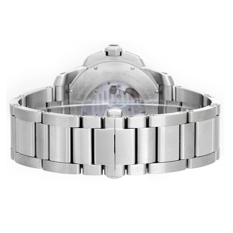 Cartier Calibre Stainless Steel Men's 42mm Watch W7100015 -  Automatic winding. Stainless steel case with exposition back  (42mm diameter). Silvered dial with Roman numerals; subseconds; date at 3 o'clock. Stainless steel Cartier bracelet. Pre-owned