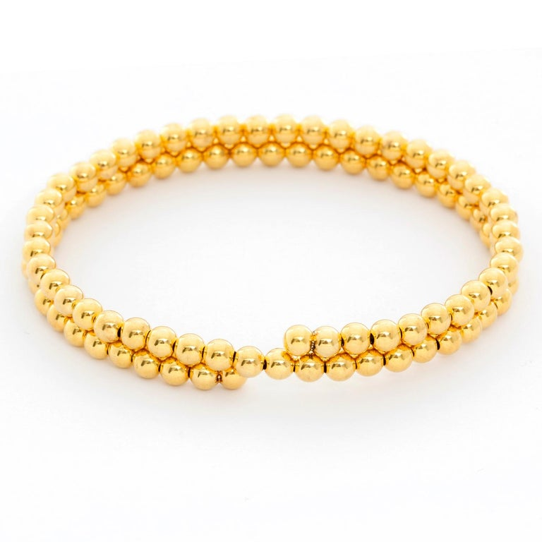 14K Yellow Gold Beaded Double Strand Wrap Bracelet  - 4mm Yellow Gold beads make up this cuff bracelet with two strands. Bracelet measures 6.5 inches but has some stretch. New with DeMesy box.