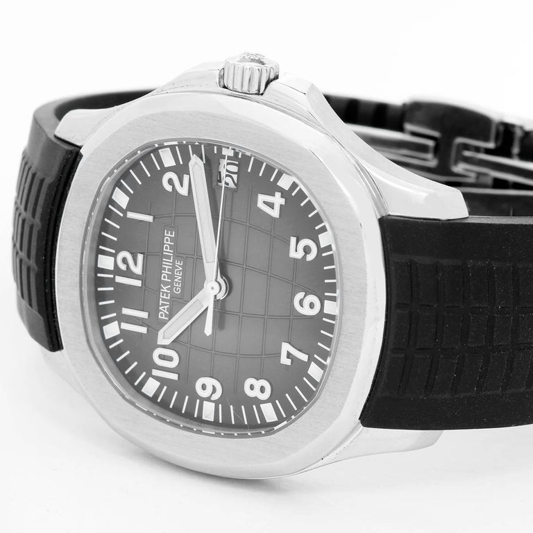 Patek Philippe Aquanaut Men's Stainless Steel  Watch 5167A-001 - Automatic winding. Stainless steel case with exposition back (40mm diameter). Black dial with Arabic numerals and luminous markers. Black rubber strap band with stainless steel Patek