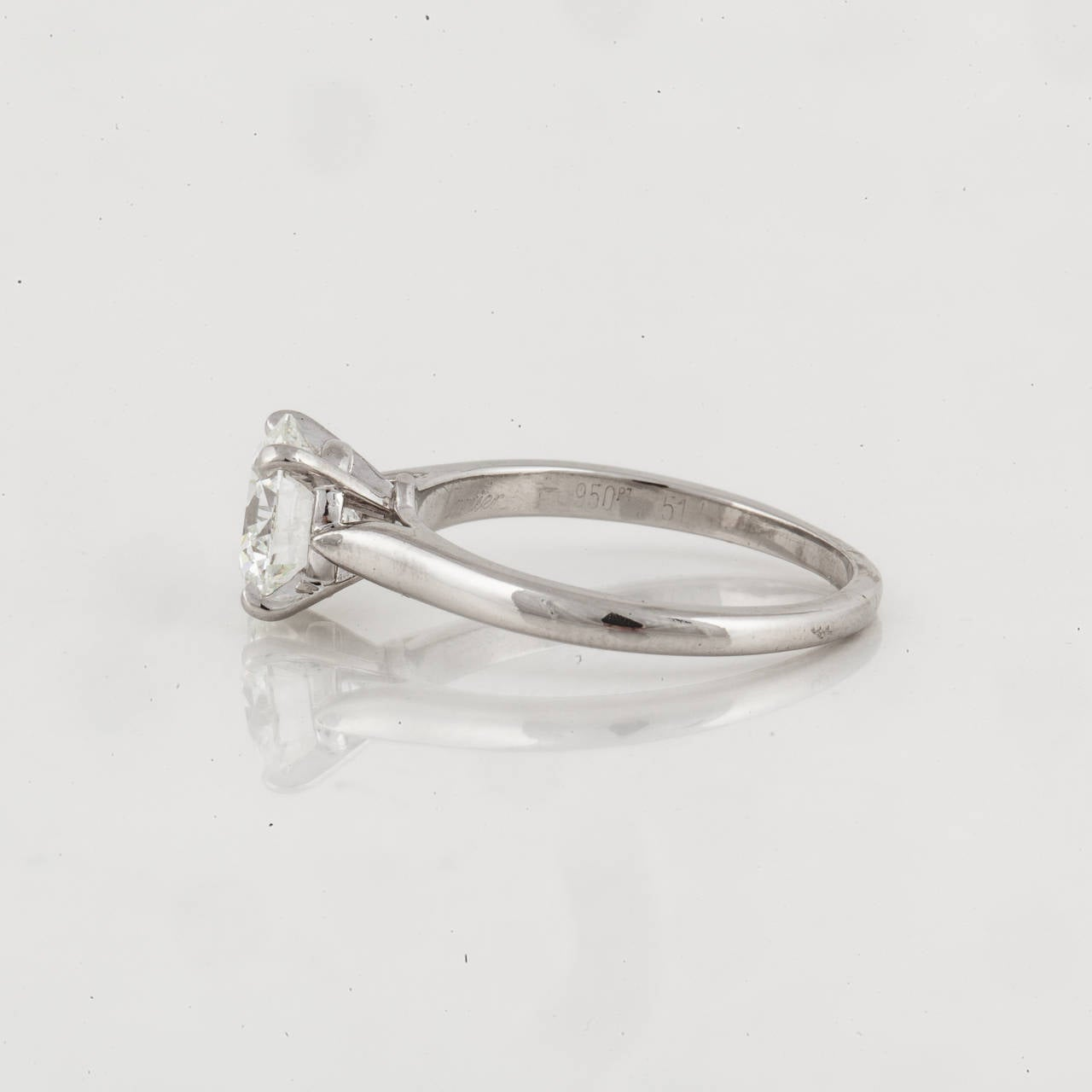 Cartier GIA Certified Diamond Platinum Solitaire Ring In Excellent Condition For Sale In Houston, TX