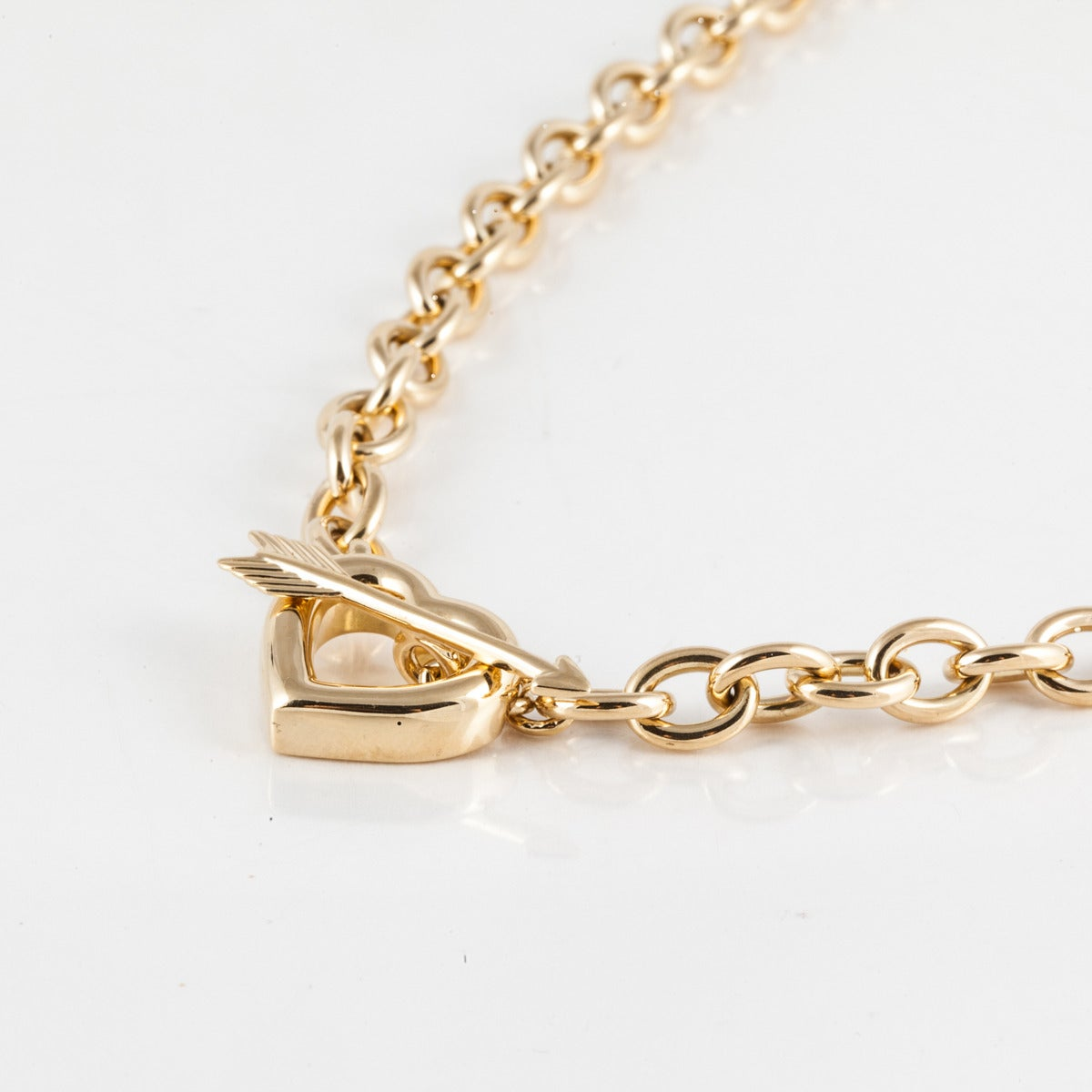 Tiffany 18K yellow gold link necklace.  Features a heart at the bottom with arrow as the toggle closure.  Beautifully made chain and very clever closure.  Fully hallmarked on back of heart.