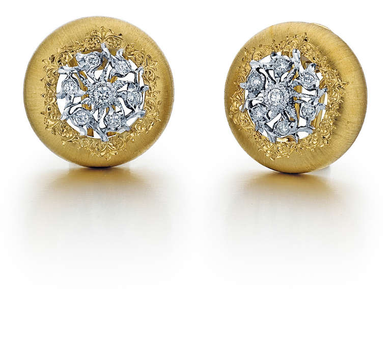 These Buccellati earrings are made in 18kt yellow gold and 18kt white gold. They have 14 round diamonds that weigh 0.32 carats total weight.