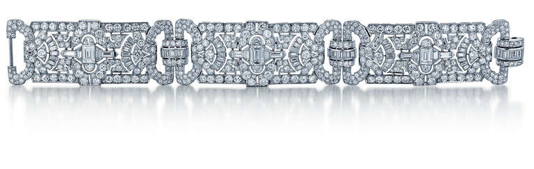This platinum bracelet from the art deco period features round diamonds that weigh 22.75 carats total weight, plus an additional 8.50 carats total weight of diamonds in other shapes. The diamonds are F-G in color and VVS in clarity. The length is 7