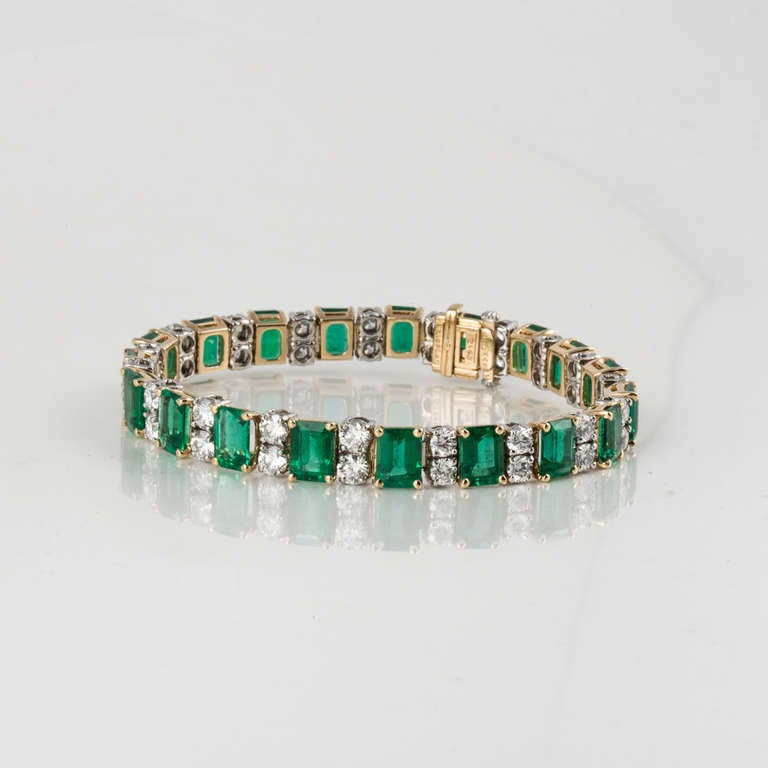 Oscar Heyman & Bros. Emerald, Diamond, and Yellow Gold and Platinum Bracelet In Excellent Condition For Sale In Houston, TX