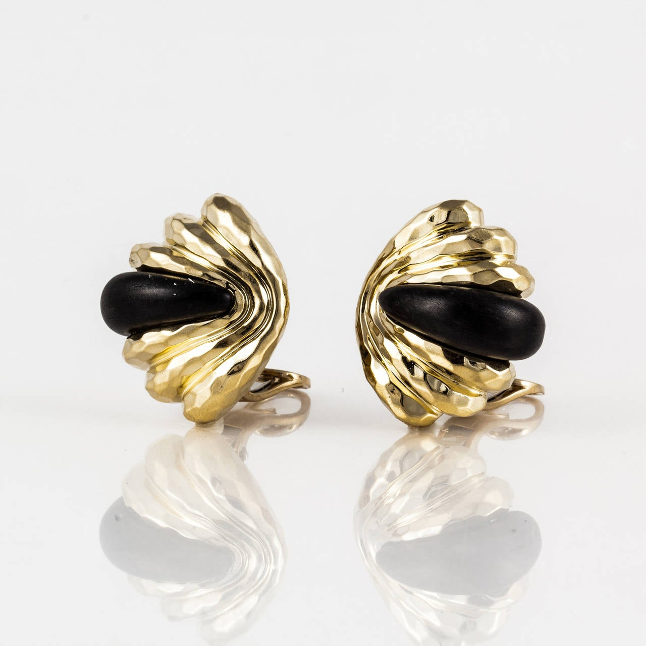 Unusual earrings by Henry Dunay.  They are hammered yellow gold with Ebony wood inserts.  Marked on the back