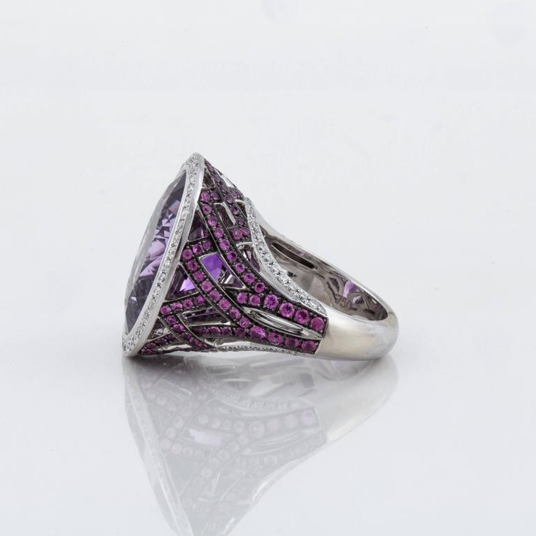 "White gold ring marked ""750 Asprey"" on the inside.  Features a large amethyst on top surrounded by diamonds.  The amethyst is 12.0 carats; there are eighty-six (86) round diamonds with a total weight of 0.90 carats.  The presentation area measures"