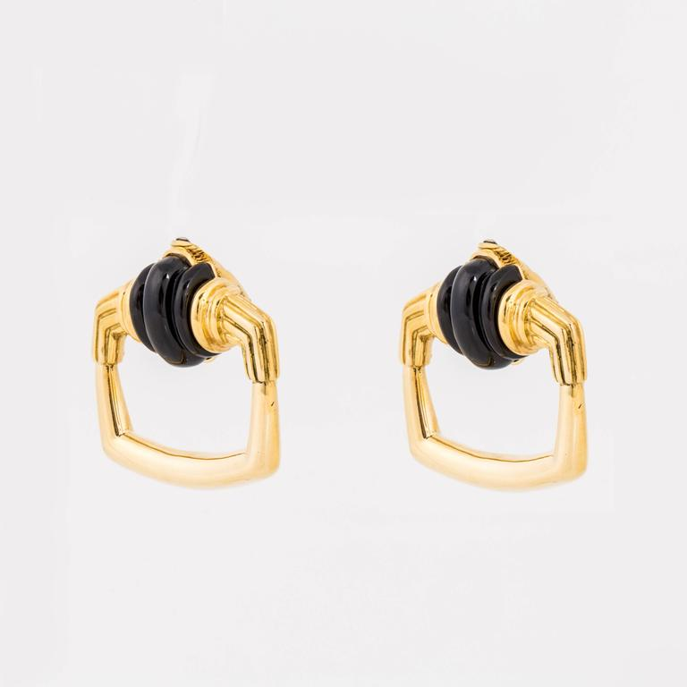 """Iconic Cartier earrings marked """"A. Cipullo 18k"""" on the back.  These are door knocker style with carved onyx tops.  Measure 1-3/8"""" x 1.5"""" and are clips."""