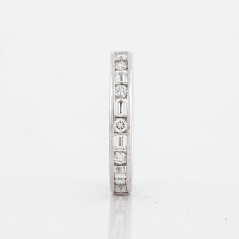 This Tiffany & Co. diamond eternity band features alternating round and baguette diamonds.  The band is marked