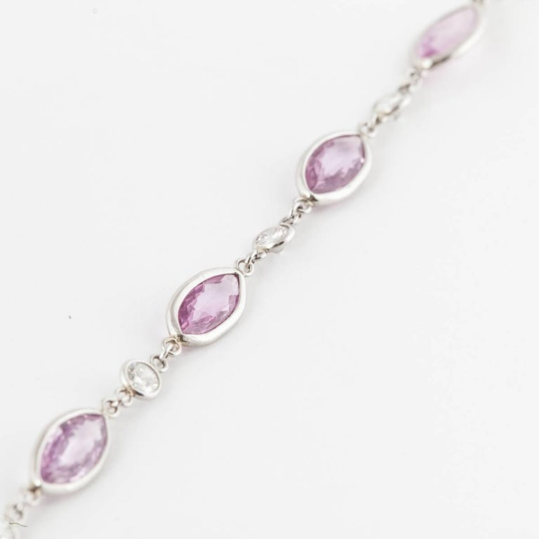 Pretty in pink and platinum.  This necklace contains forty-nine (49) pink marquise sapphires totaling 33.9 carats.  There are also forty-nine (49) round diamonds totaling 3.25 carats.  Necklace measures 36