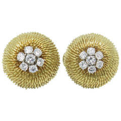A Pair of Yellow Gold and Diamond Earrings.