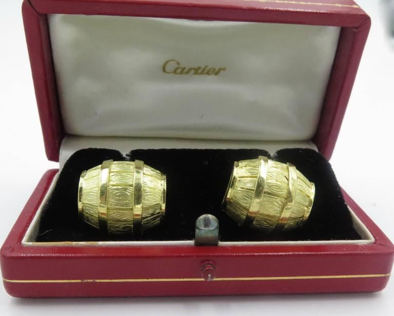 A pair of 18 karat yellow gold cufflinks.  Cartier. Circa 1970.  Signed Cartier 27958.  Each double link designed as a larger and smaller barrel. Accompanied with original box.  Length is approximately 3/4 inches .Gross weight approximately 22.5