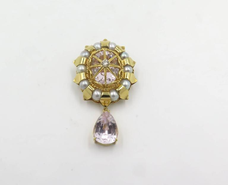 An 18 karat yellow gold, cultured pearl, Kunzite and diamond brooch.  Signed Tony Duquette.  With bail, can be worn as a pendant. Length is approximately 2 1/4 inches. Gross weight is approximately 29.1 grams.