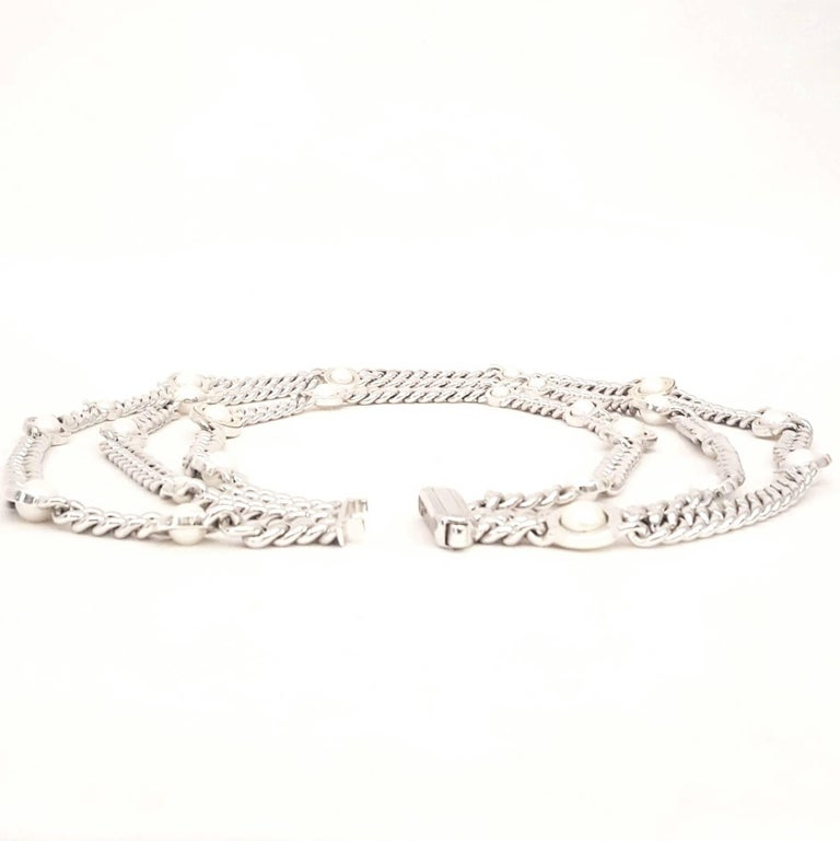 Franco Pianegonda is an artist, sculptor and artisan from Vicenza, a city renowned for centuries for handmade gold and silver manufacturing. This stunning three strand necklace is a standout example of his artistry.  Curved link sterling silver