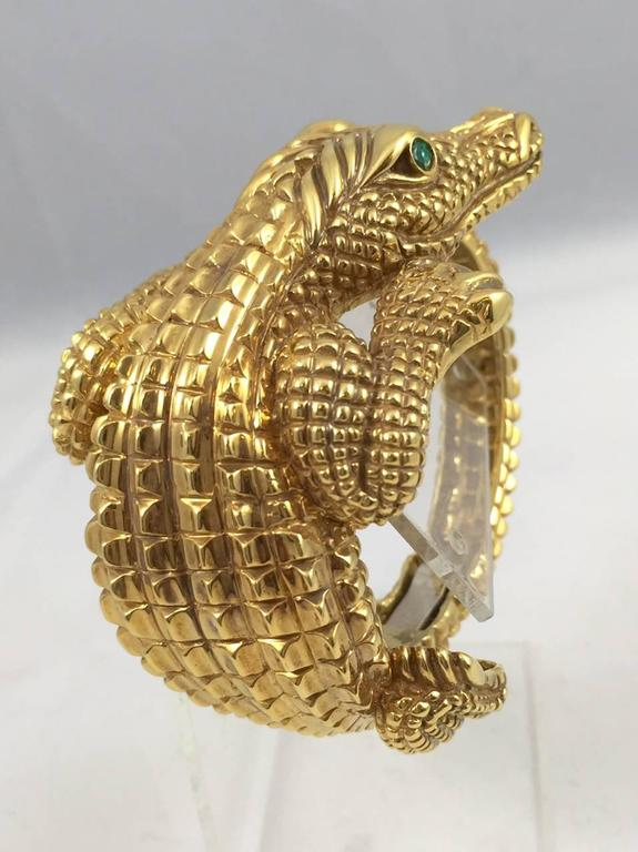 University of Florida folks and animal lovers everywhere will be drawn to this 18 karat yellow gold bracelet!  This amazing bracelet does not have one spot that isn't highly detailed!  Smartly designed with a clamper feature, it opens wide to fit