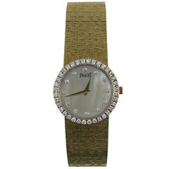 Piaget Lady's Yellow Gold Mother of Pearl Diamond Quartz Wristwatch