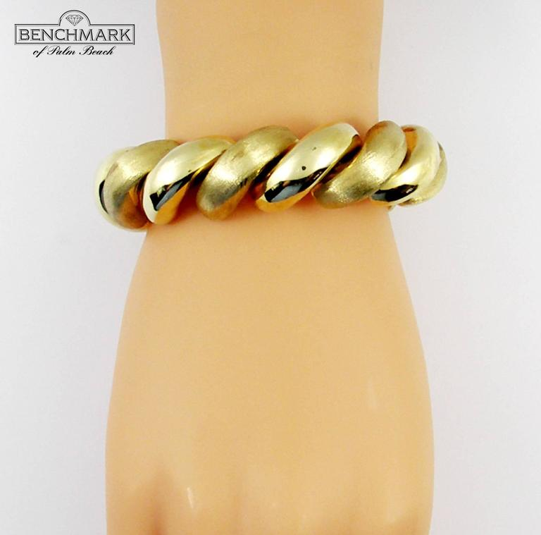 Polished and florentined gold san marco bracelet at 1stdibs for What is gold polished jewelry