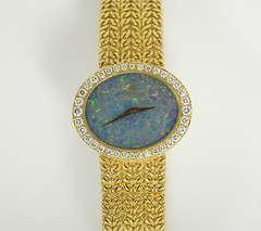 Bucherer Lady's Yellow Gold and Diamond Bracelet Watch with Black Opal Dial