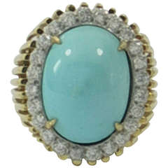 Turquoise Ring in Gold with a Halo of Diamonds
