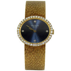 Patek Philippe Lady's Yellow Gold and Diamond Bracelet Watch with Blue Dial