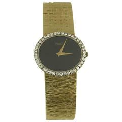 Piaget Lady's Yellow Gold Diamond Oval Shaped Onyx Dial Bracelet Wristwatch