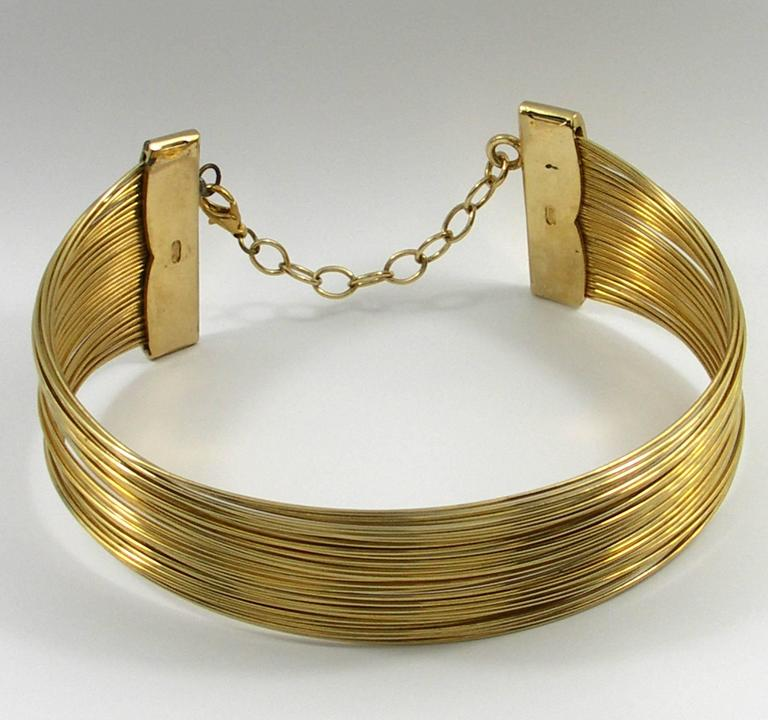 """A costume """"J'adore"""" collar necklace by Christian Dior, measuring 2 inches at the ends, and approximately 1 5/8 inches in the center. Will fit necks up to 15 inches."""