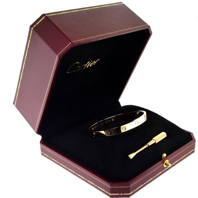 From Cartier's LOVE Collection:  Bracelet Size: 18 = 18 cm Metal: 18 Karat Rose Gold Stones: 4 Brilliant Round Cut Diamonds Total Carat Weight: 0.42 carat Collateral: Box and Certificate of Authenticity Hallmark: Cartier 750 Serial No. 18  This