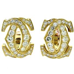 Cartier Signature Double-C 18 Karat Yellow Gold Diamond Clip on Earrings