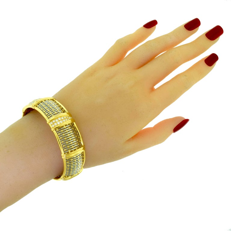 Designer: Cartier Metal: 18k Yellow Gold, Stainless Steel Stones: 14 Round Brilliant Cut Diamonds Total Carat Weight: approx. 1.0 ct Diamond Color: D E F Diamond Clarity: IF - VVS Total Item Weight (g): 58.5 Band Width: 18.22 mm Hallmark: Cartier