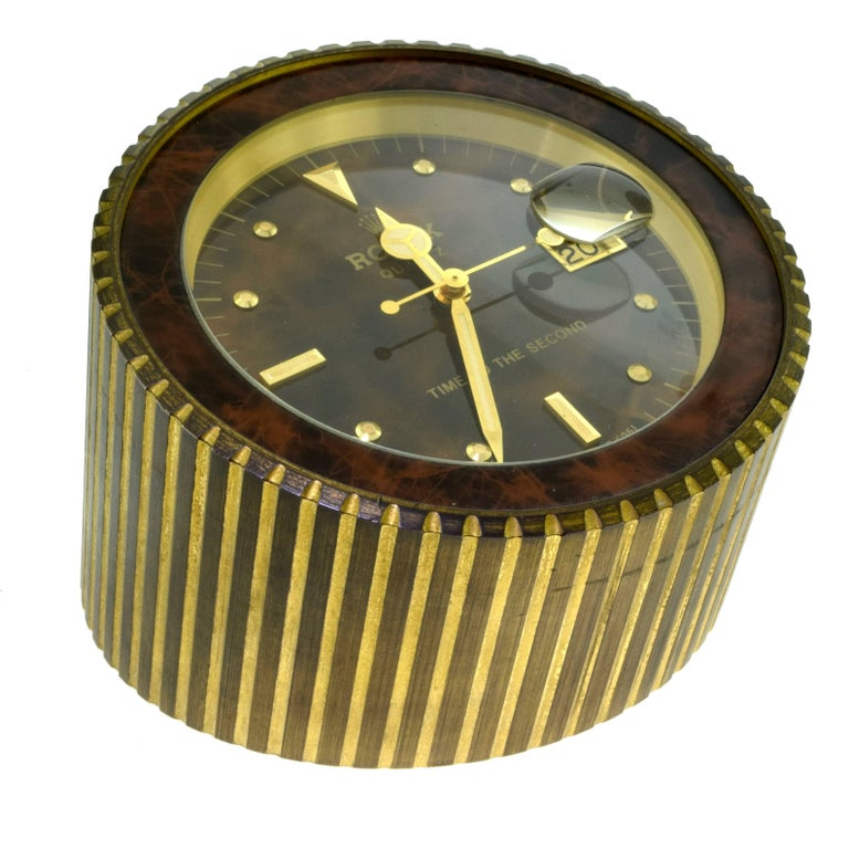 "Brand: Rolex Ref. No.: 455  Total Item Weight (g): 2335 Diameter: 4.75 inches Height: 2.5 "" tapering up to 4 "" Battery Operated​​​​​​​  Rolex. A Gilt Metal Quartz Desk Clock with Dead Center Seconds and Date  Signed Rolex"