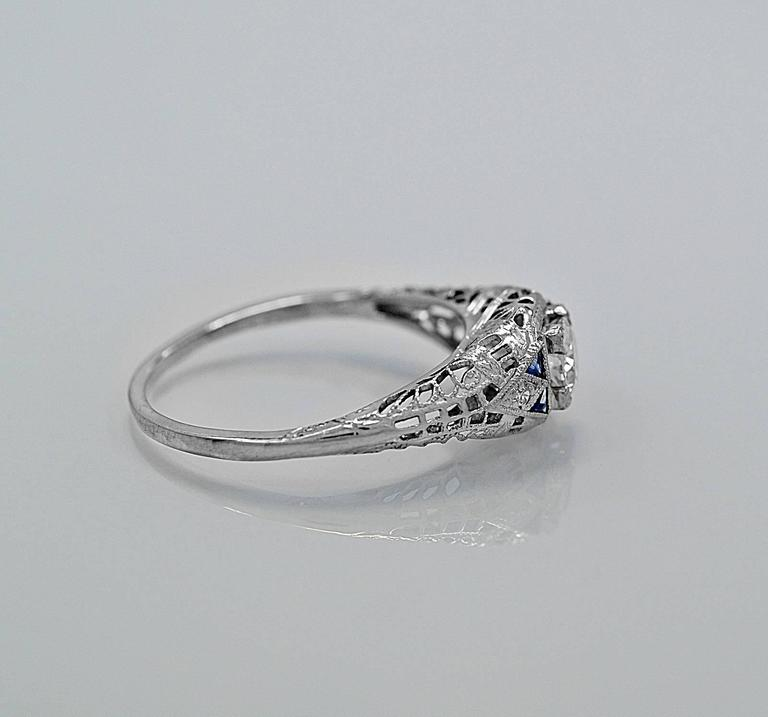 An Artfully Filigreed Antique Engagement Ring Crafted In Platinum And Features A 31ct Apx