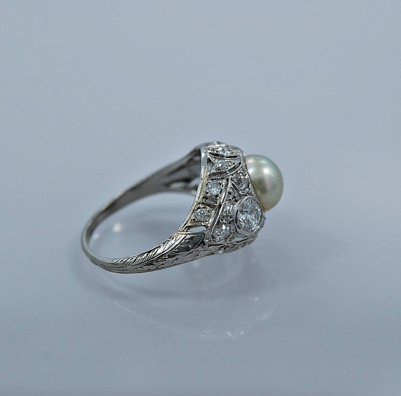 unique edwardian pearl platinum engagement ring at