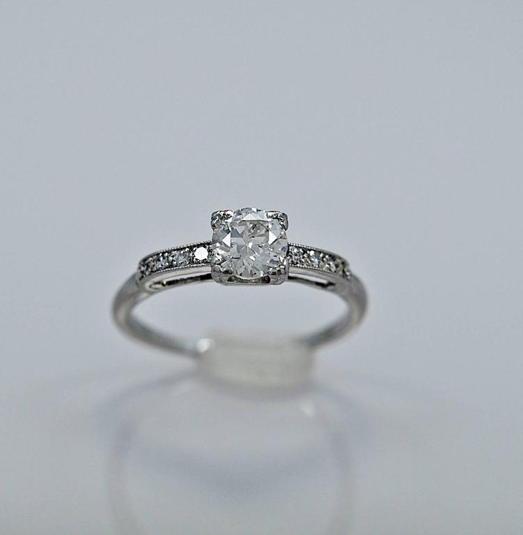 Lovely Art Deco platinum & diamond engagement ring featuring a .54ct. apx. diamond of SI2 clarity and H color. The diamond melee weighing .08ct. apx. T.W. adds a touch of elegance to this classic style engagement ring. Very dainty and feminine!