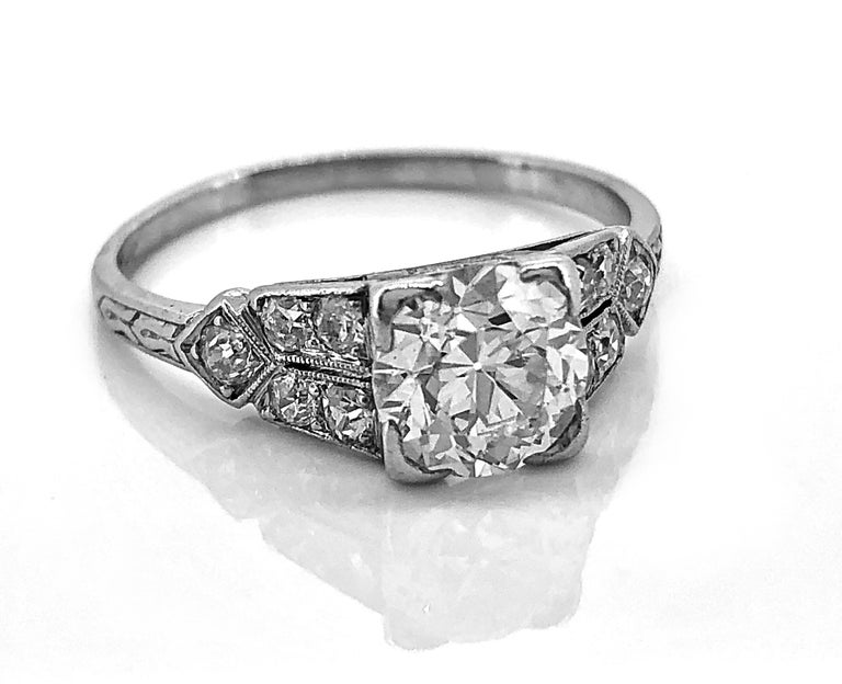 A lovely Art Deco Diamond and Platinum Antique Engagement Ring featuring a 1.16ct. apx. European cut Diamond with SI1 clarity and I color. The accenting .30ct. T.W. apx. diamond melee are set in a split shank style making a lovely and crisp design.