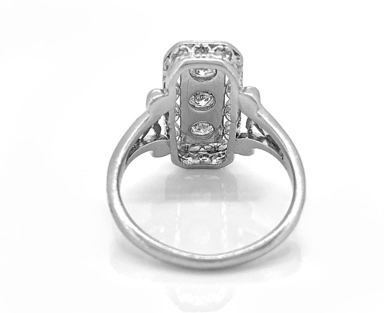 Clic Winston Round Brilliant Enement Ring With Pear Shaped Side Stones