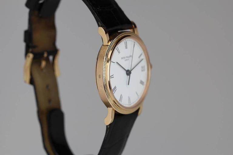 Patek Philippe Rose Gold Calatrava Wristwatch Ref 3802/200R  In Excellent Condition For Sale In Miami Beach, FL